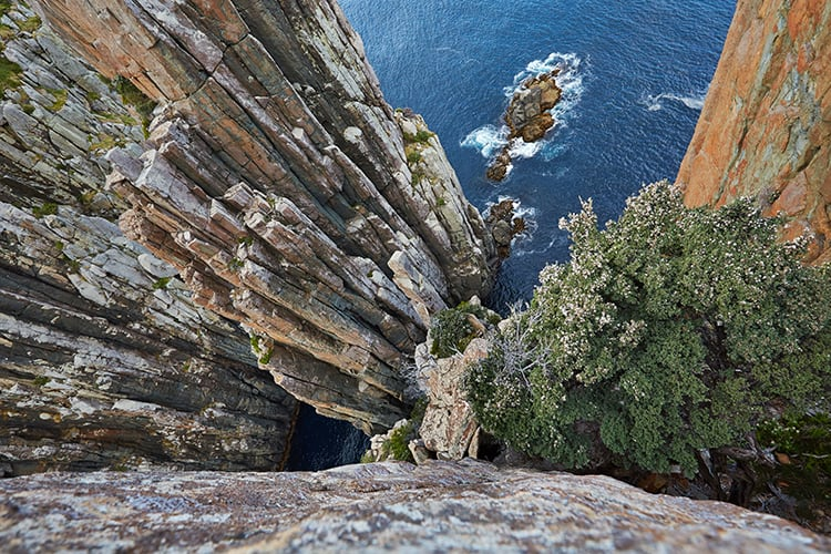 Things to do in Tasmania - Cape Hauy cliffs in Tasmania with the Candlestick and the Totem Pole