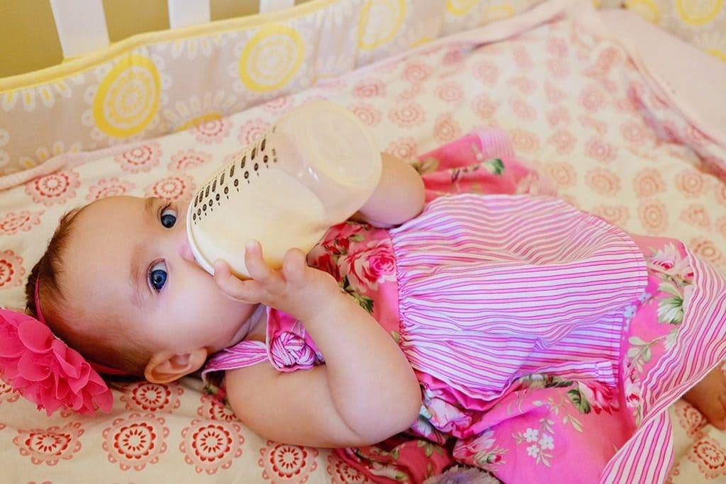Avalee drinking a bottle