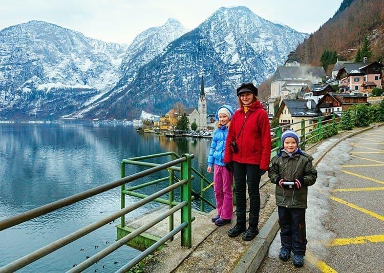 Family in Hallstatt town (Austria). Winter view.