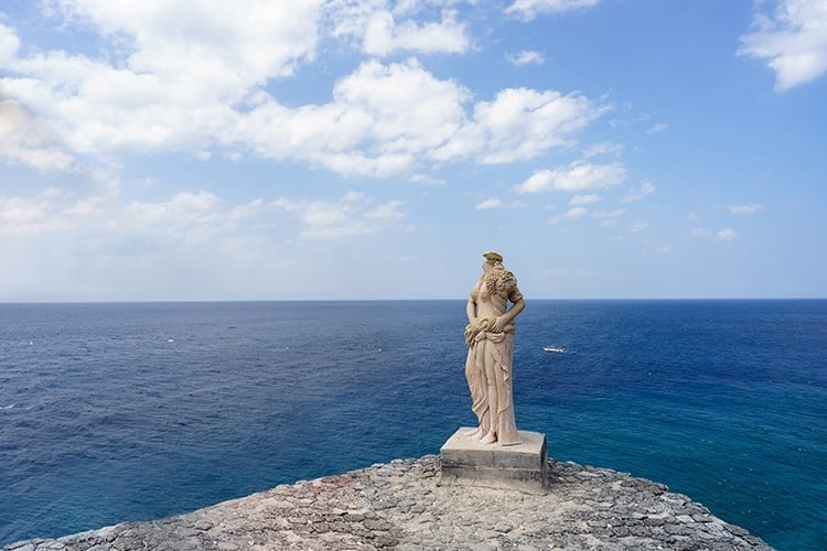 Grecian statue on cliff side in Fortune island