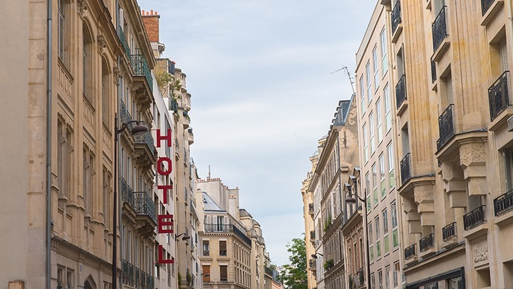 Paris, typical street with the hotel panel, big letters