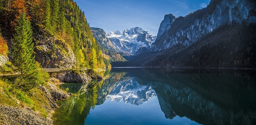 Mountain scenery in the Alps with Dachstein summit reflecting in Lake Gosausee, Salzkammergut, Austria
